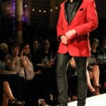 Jeff Feswick in a red jacket by designer Angela DeMontigny