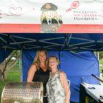 Shaunna Rainey and Kathy Thomas selling raffle tickets.