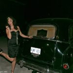 Justine strikes a pose with the hearse