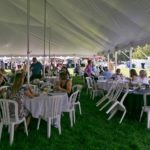 Enjoying the event under the tent