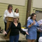 Judy Marsales having fun during the Heads and Tails game