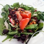 Asian greens with tomato, cranberries, and radish to start